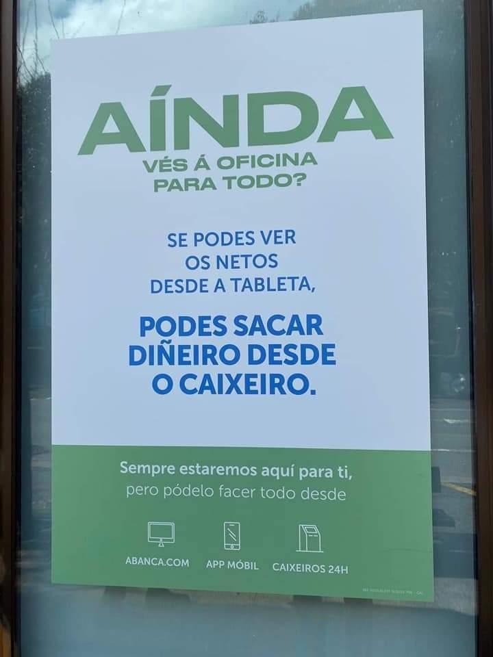 Uno de los carteles promocionales en una sucursal de Abanca